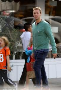 Chris Martin takes kids out while Gwyneth Paltrow heads